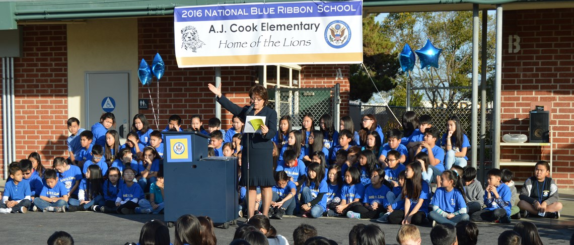 Principal Sandi Ishii congratulates Cook on its distinction as  National Blue Ribbon School!