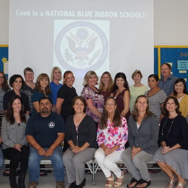 Our staff join in for a photo at the Blue Ribbon ceremony.
