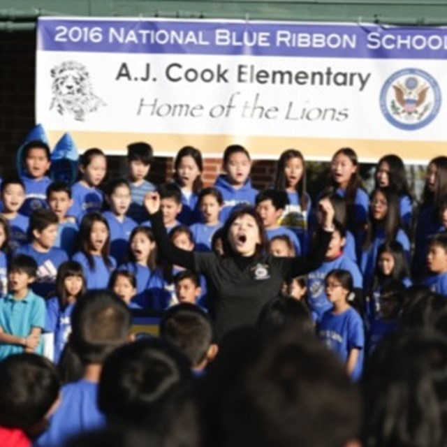 Choir students sing in honor of being awarded a National Blue Ribbon school.