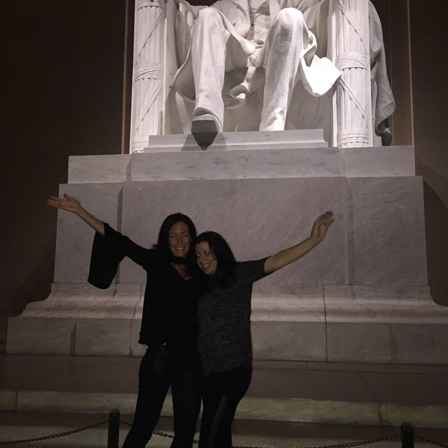 These two friends pose for a photo in front of Abraham Lincoln's statue.