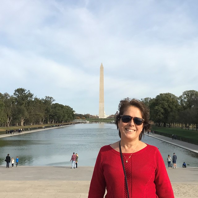 A wonderful educator stands miles away from the Washington Monument.