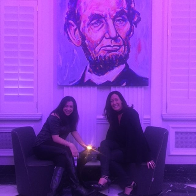 These two lovely ladies take a photo with Abraham Lincoln, the fifth president of the United States.